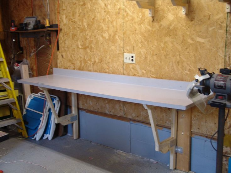 Make A Cheap Fold Down Workbench Wood Projects Organizing And Woods