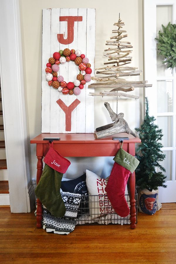 """Instead of a traditional sign that reads """"Joy"""", replace the 'O' with a wreath that incorporates all colors of the holiday. See more at Liz Marie Blog »   - GoodHousekeeping.com"""
