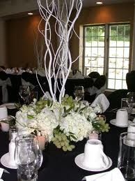 Full centerpiece featuring hydrangeas, grapes and white willow