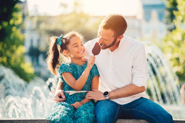Little girl in the park giving ice-cream to hеr father | Young fathers, Photo, Stock images free
