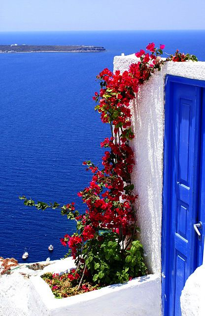 .Loved this picture ... it captures the blue blue blue of the water (center of a volcano) and the color they use on doors, shutters and domes all over the beautiful island of Santorini