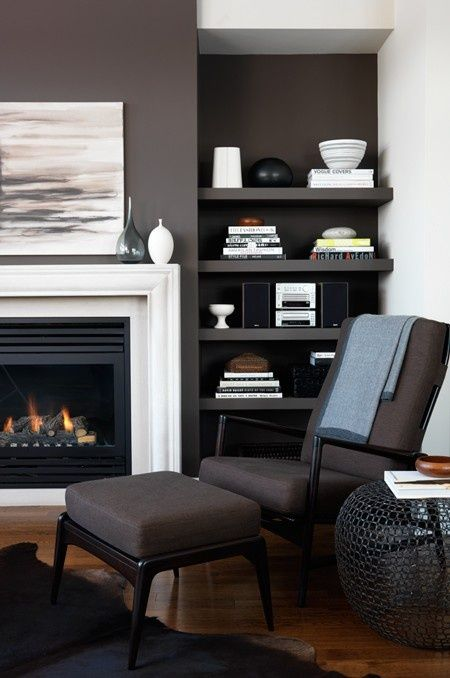 """love the wall color. The white fireplace and accents pop against walls painted a warm shade of dark brown.                Erika Federspiel of Toronto won """"Best Living Room Transformation"""" in our 2008 design contest for this character-filled space. Erika had the Danish chair and ottoman refinished and reupholstered to work with the room's black, grey and brown palette."""