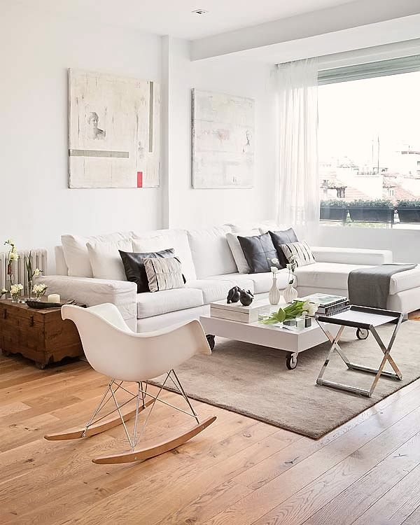 the rocking chair!and the muted shades of grey and charcoal contrasting with pristine white