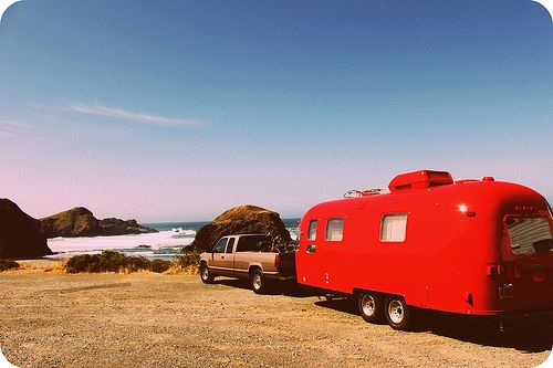 cheery red airstream.  ~~and the ocean~~cant beat it!