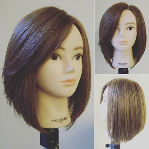 Round Graduated Back With Triangular One Length Front And Side Swept Fringe Hair