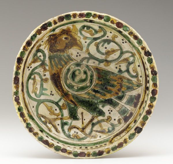 Bowl  12th-13th century    Saljuq period     Earthenware incised and painted with polychrome glazes  W: 26.7 cm   Afghanistan