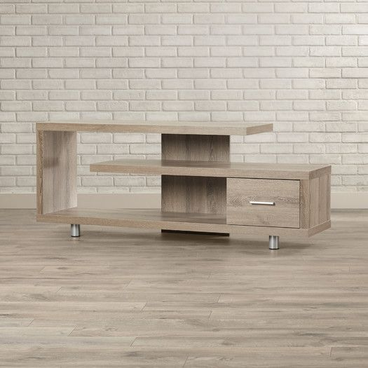 "Features:  -Reclaimed-look.  -Closed storage drawer.  TV Size Accommodated: -47"".  Product Type: -TV Stand.  Design: -Enclosed storage.  Finish: -Dark taupe.  Frame Material: -Manufactured wood.  Piec"