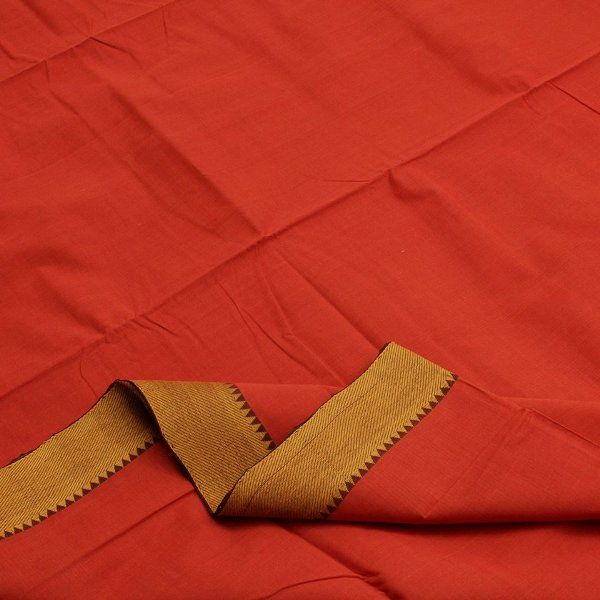 A refreshing vermillion orange #sari with a striking #Bavanji border in warm gold colour. The inner edge of the border is embellished with a row of tiny temples. Complete with a running blouse. Code 400508983.