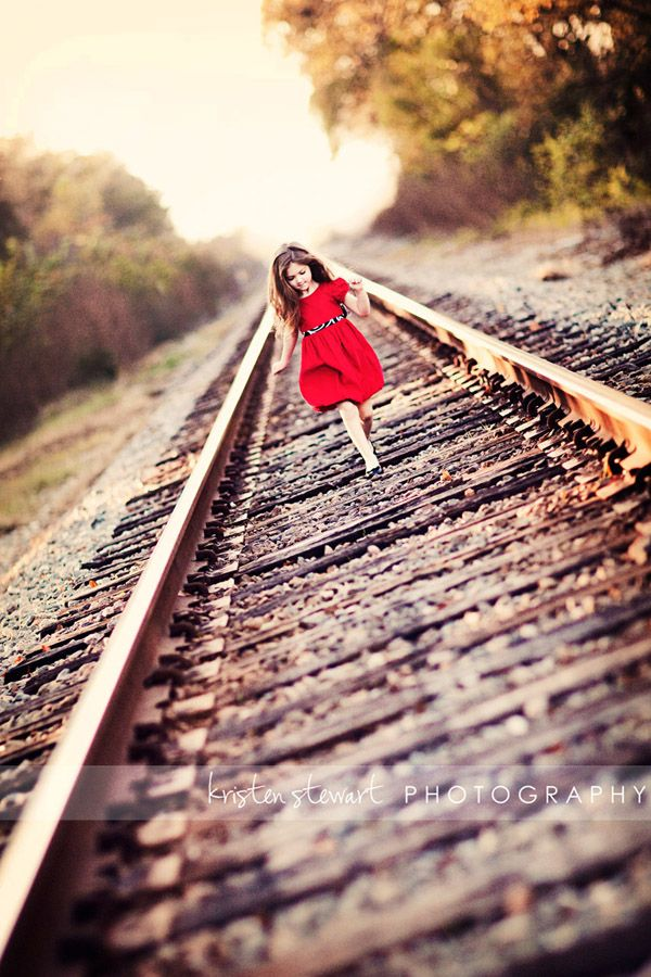 Want to get a picture like this with my sister and I.  We used to walk the train tracks all the time as kids!