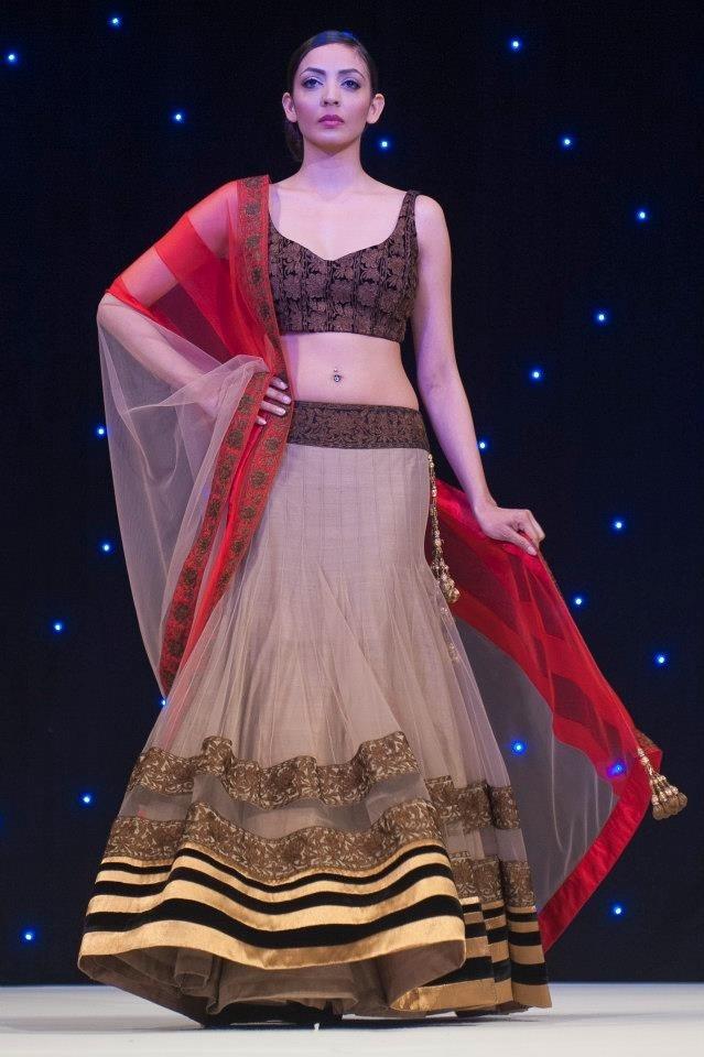 Manish Malhotra nude and red lehenga.