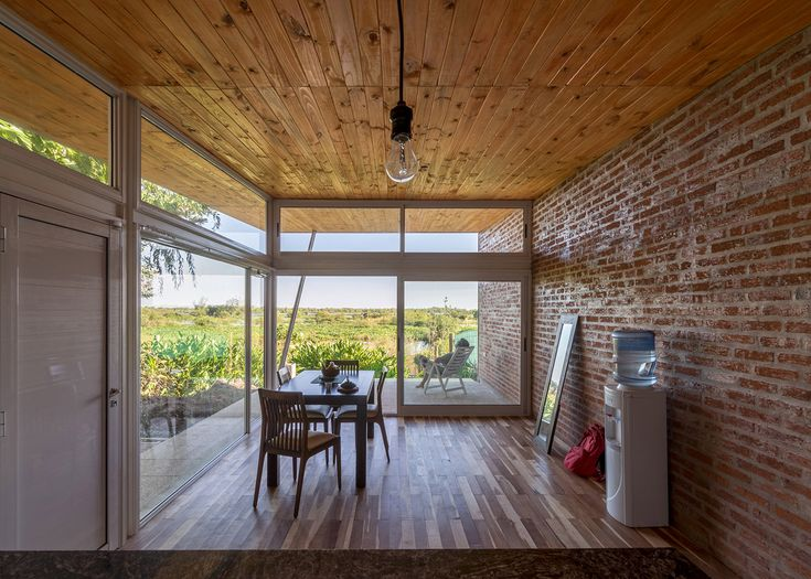 Both rooms and terraces are sheltered beneath the roof of this house in Argentina, designed by architects office Celula Urbana.