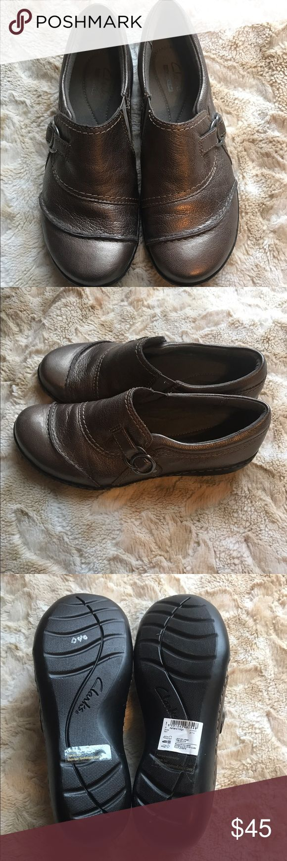 Clarks Ashland Indigo Shoe Clarks size 7 Ashland Indigo slip on shoe/clog. Leather Upper. Never worn. Brand new, flawless condition. Foam type insole, fashionable buckle on side. Clarks Collection Clarks Shoes Mules & Clogs