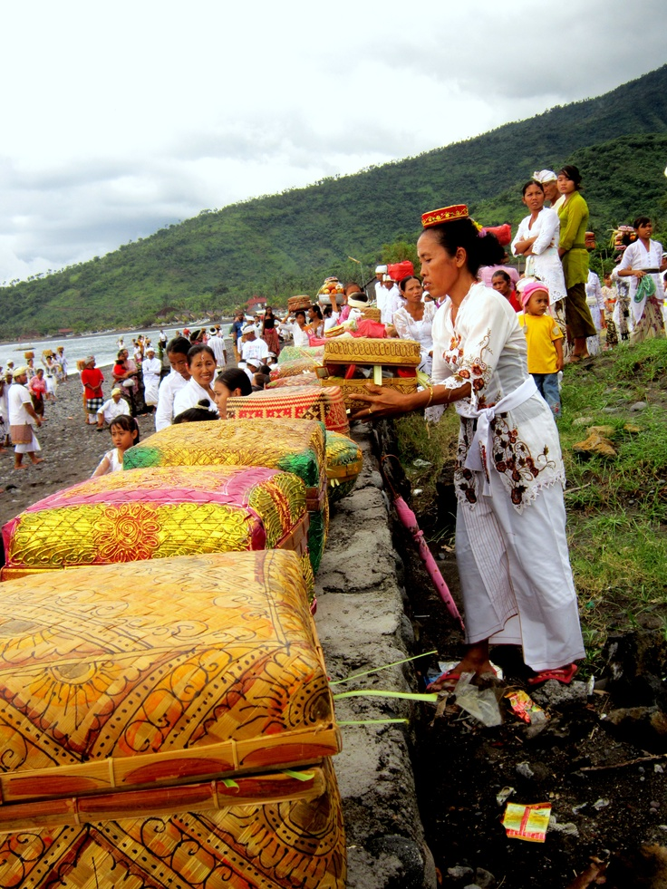 Woman puts basket down during 'cleansing' Ceremony 2 days before Nyepi