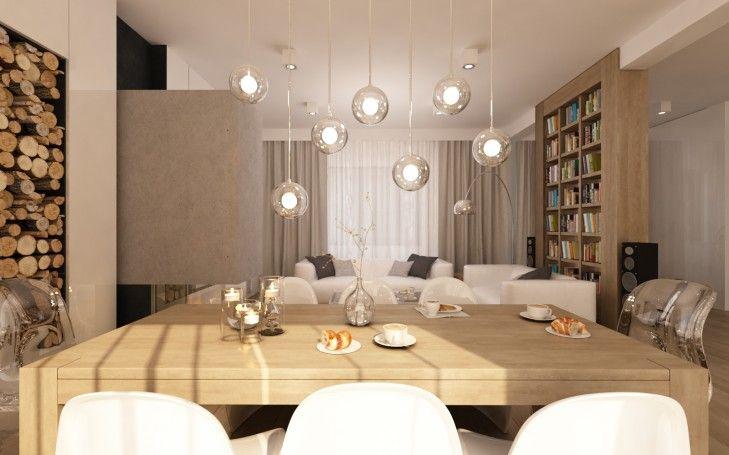 Projekt wnętrza jadalni z widokiem na kominek i salon. Nad stołem szklane lampki Bocci a na zwieńczeniach stołu krzesła Him i Her
