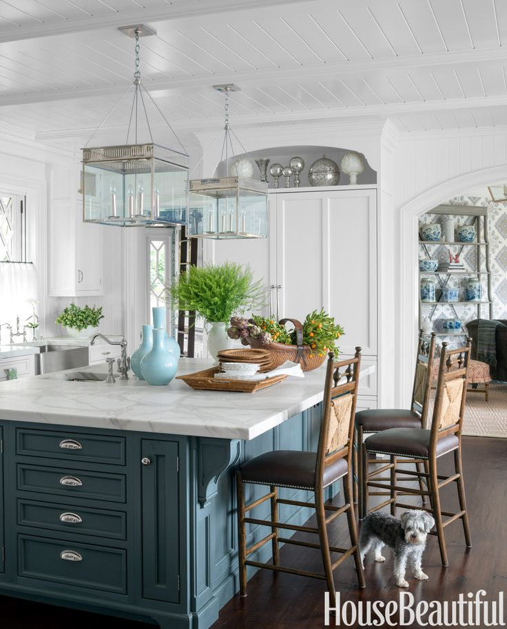 Farrow & Ball's Down Pipe on the island cabinetry grounds the otherwise all-white kitchen in a Greenwich, Connecticut, house decorated by Lee Ann Thornton. Pendant lights, the Urban Electric Co.   - HouseBeautiful.com