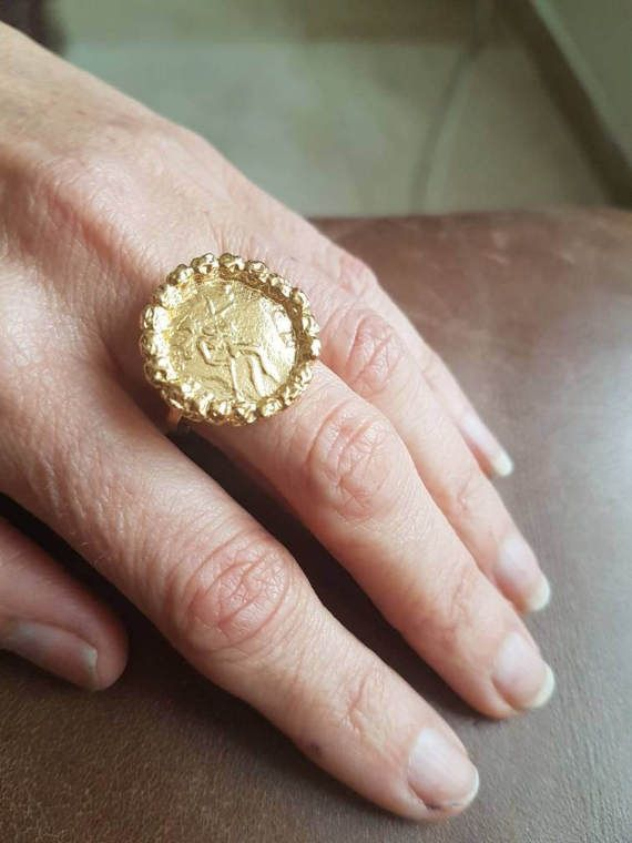 Check out this item in my Etsy shop https://www.etsy.com/il-en/listing/214920203/gold-coin-ring-antique-coin-ring
