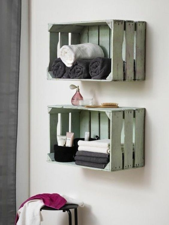 Painted crates mounted as shelves make for the perfect place to keep towels and toilet paper:
