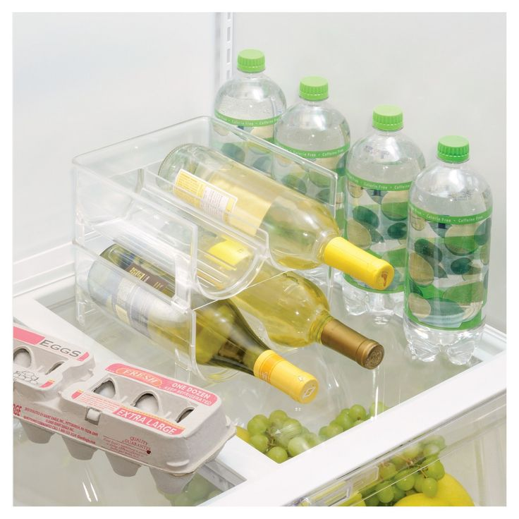 The InterDesign Fridge Binz 2-Bottle Stackable Wine Holder is the solution for keeping your favorite wine cold and accessible. Made of durable, BPA-free clear plastic, this wine rack holds up to two bottles and is stackable. Hand wash with mild detergent and water. Do not clean in the dishwasher. Coordinates well with other items in InterDesign's Fridge Binz collection.