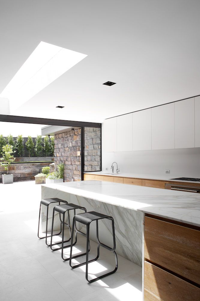 Daylight entering the kitchen inside the Dale House by Robson Rak Architects