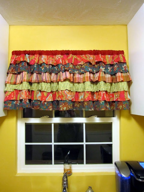 Recycled Aprons Make A Super Cute Kitchen Valance.
