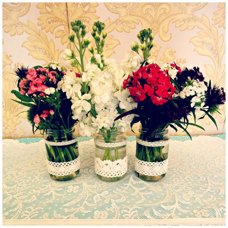 Tea party flowers in mason jars with lace at Buy My Dress Waterford