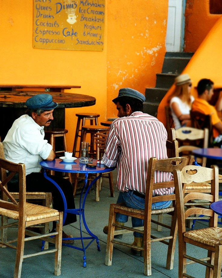 Greece travel photography. I found these two men in a Greek cafe in Santorini. We were just getting ready to walk up the donkey path and I was struck by the rich coloring and classic Greek scene in this quaint cafe.    TITLE: Two Men in a Greek Cafe  LOCATION: Santorini, Greece