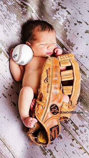 Newborn baby boy in baseball mitt by lottie