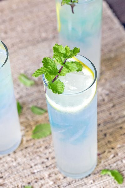 The pretty light blue color of this raspberry spiked lemonade spruces up your average fresh and fruity drink tray.