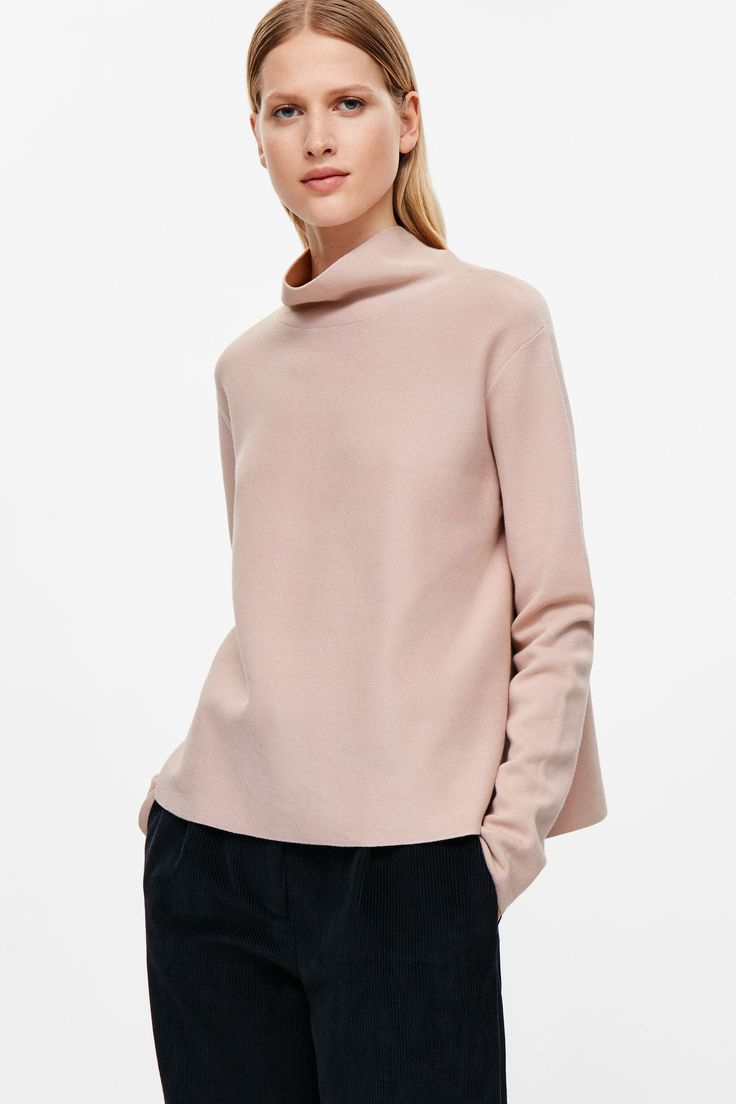 This high-neck jumper is made from a Milano knitted cotton with a melange…
