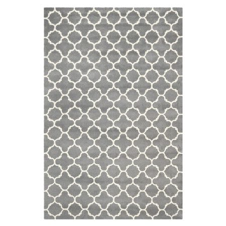 Add a dash of stylish flair to your floors with this eye-catching rug, showcasing a quatrefoil trellis motif and hand-tufted wool pile.    ...