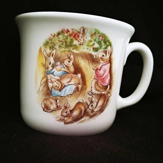 The Flopsy Bunnies Bone China Mug  -This darling mug was made in 1986 in England for a series by F. W and Co. called The World of Beatrix Potter.  -Features the Flopsy Bunnies  -Dimensions: Approximately 3 tall  -Condition: Good. May have light wear due to age including slight