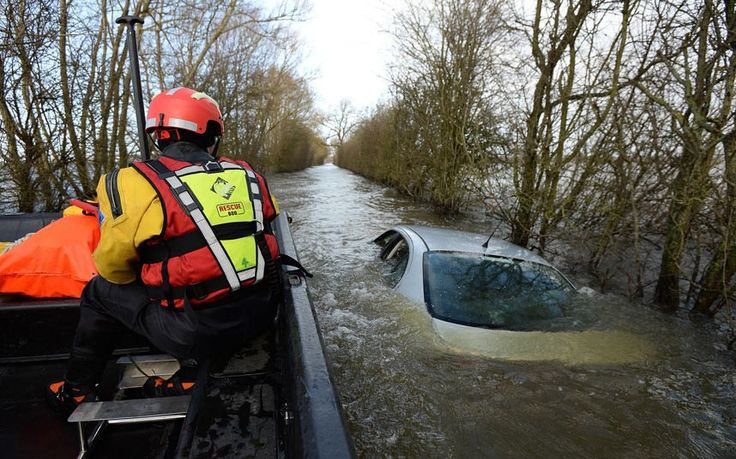 UK weather in pictures: Heavy rain, floods and snow falls on higher ground - Telegraph