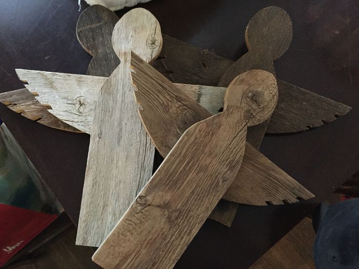 Angels out if old fence wood