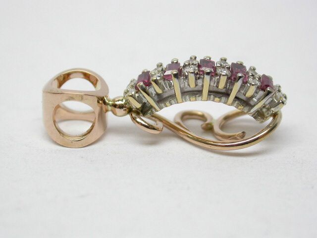"""AFTER We removed the ruby and diamond setting, added our lace underrail and """"fistula"""" style bail to create a pendant"""