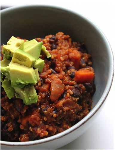 Vegan Quinoa Sweet Potato Chili  one can of black beans, one can of tomato paste, one vegetable stock, 1 onion, chopped, 5 cloves garlic, mince, 1 tablespoon chili powder, 1 tablespoon cumin, 1 teaspoon oregano, 1 tablespoon olive oil, 1 sweet potato, 1 cup dry quinoa, salt and pepper to taste, avocado, cilantro for garnish.