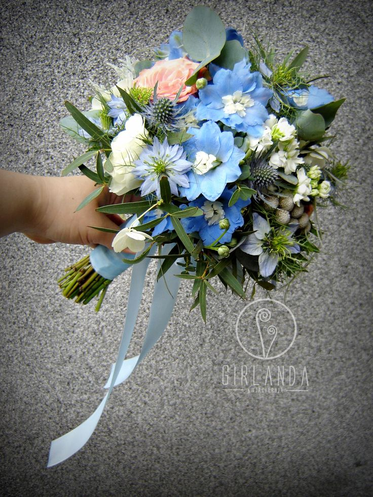 Wedding bouquet withe blue Delphinium and cappuccino Roses.