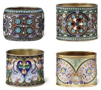 A GROUP OF FOUR RUSSIAN SILVER-GILT AND CLOISONNE ENAMEL NAPKIN RINGS