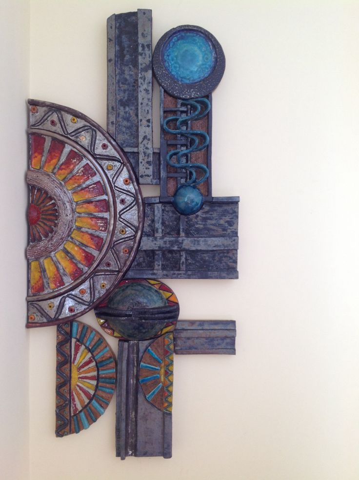 Duvar panosu hand made ceramic wall tile -   IDea for creating a sun that a moon can slot over somehow?