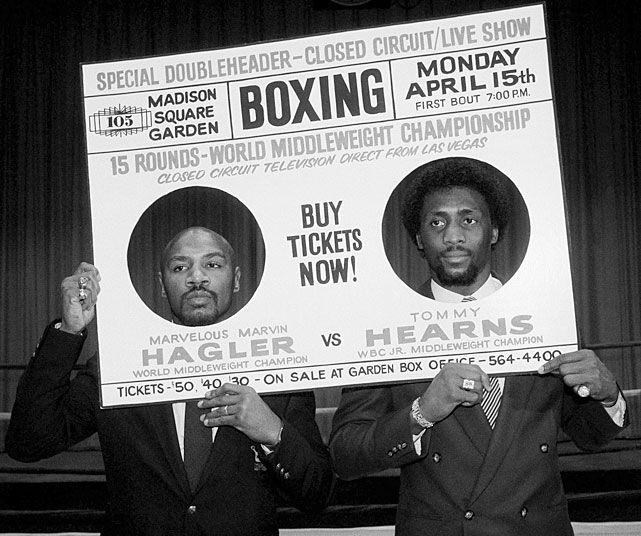 """Marvelous"" Marvin Hagler and Tommy ""Hitman"" Hearns hold up a mock-up of a boxing poster at a New York  press conference promoting their 1985 fight. Hagler would win by third round TKO in one of the most memorable bouts in boxing history. (AP Photo/ Ed Bailey)  GROVES: Classic Hagler-Hearns fight turns 25 (4.16.10)"
