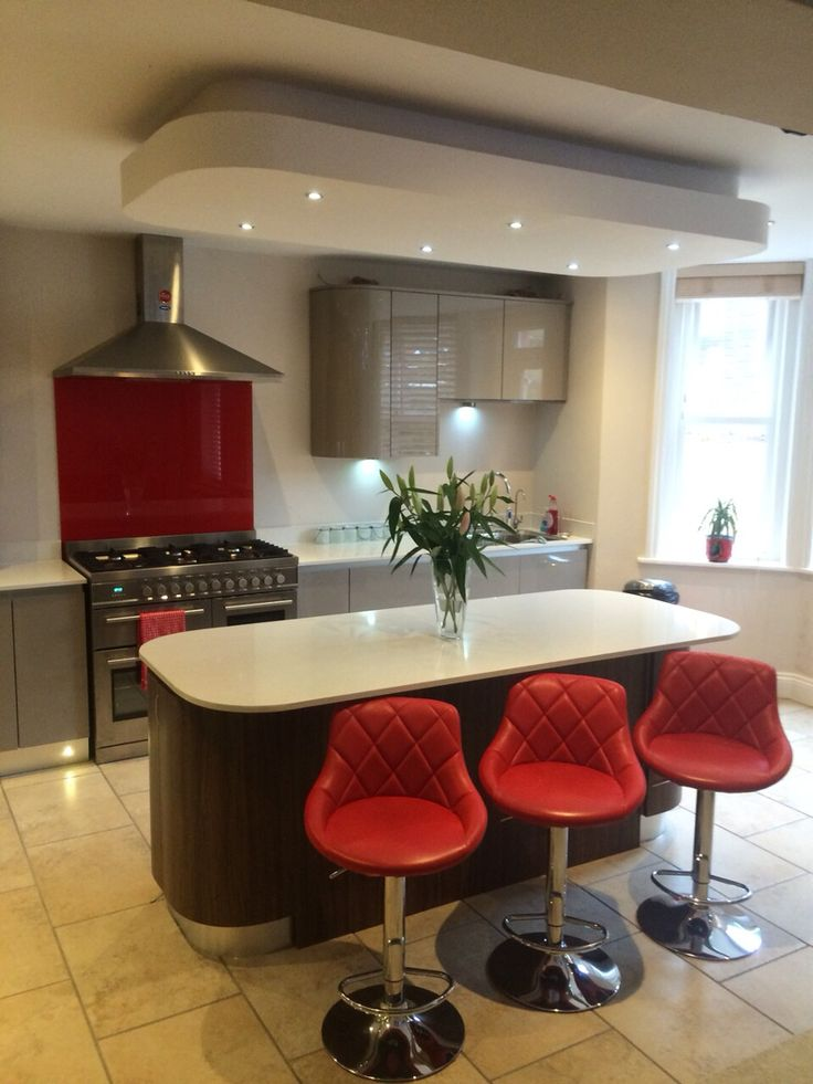 High Gloss Handleless Coffee Coloured Kitchen With Contrasting Island False Ceiling Creates A