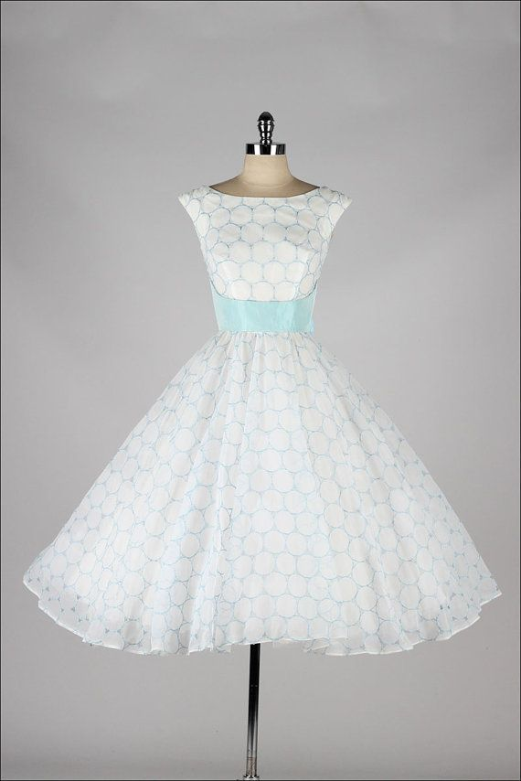 Im in love with this 50's white dress with a bluesky belt