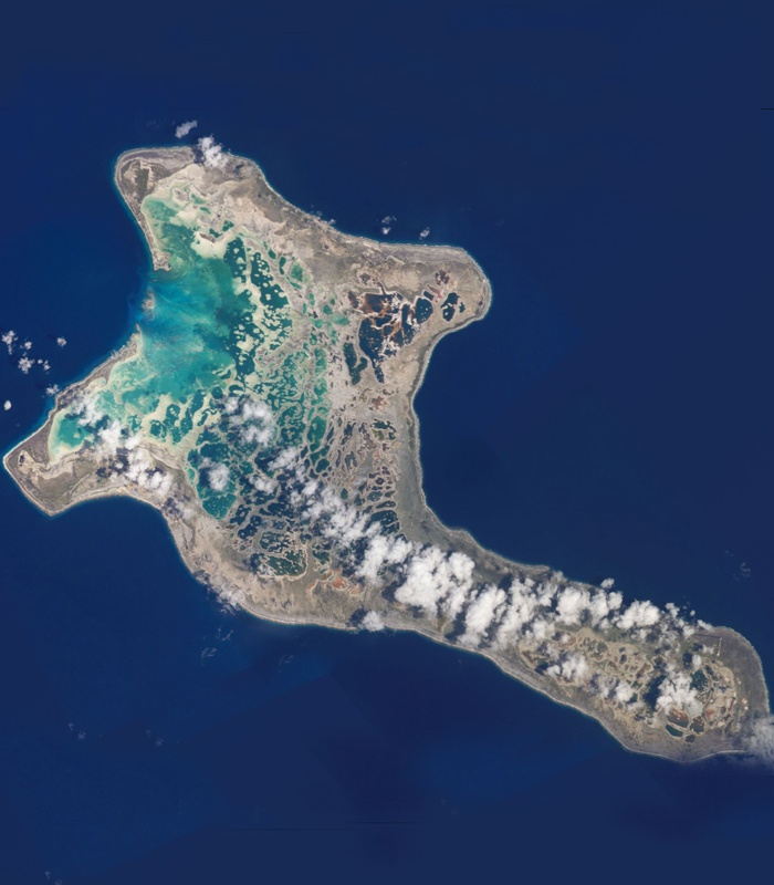 Kiritimati, or Christmas Island, in the Kiribati Line Islands is the largest coral atoll in the world. It is larger than the Mediterranean island of Malta. The Kiribati Line Islands are the world's farthest forward time zone, welcoming a new day 14 hours before Greenwich Mean Time.