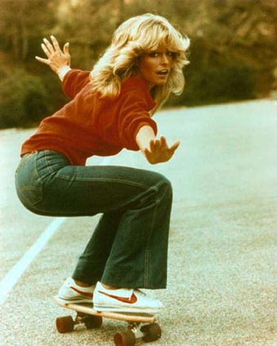 Farrah Fawcett in bell bottom jeans.