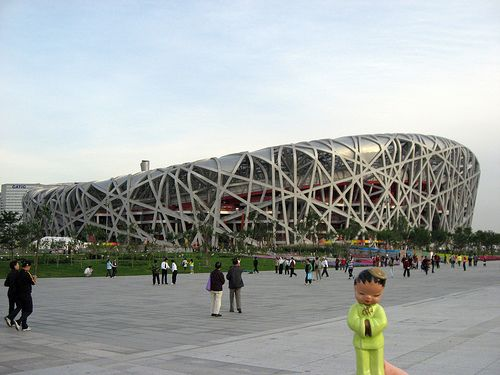 "Where is Michi? - Beijing National Stadium - Beijing China. Hello from Beijing China where I'm just outside of the Beijing National Stadium. The Beijing National Stadium also know as ""The Birds Nest"" was home to the 2008 Summer Olympic Games. The stadium hosted the Opening and Closing Ceremonies, athletic events, and football final of the 2008 Summer Olympics, from August 8th to August 24th, 2008. More info on site."