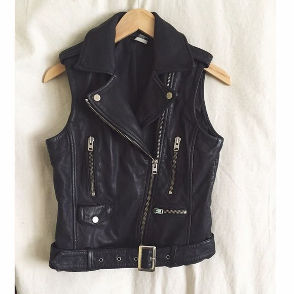Topshop leather moto vest High quality topshop leather vest with zippers and buckle detailing. So cute worn open or closed. Size US 4. The leather is high quality and is so buttery soft. Never worn! Retail $240 Topshop Jackets & Coats Vests