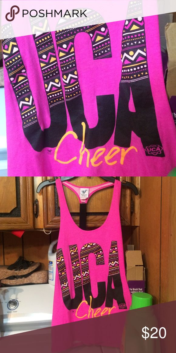 "Varsity Spirit UCA CHEER tank size small Wore once. Bought at cheer camp Says ""UCA cheer"" and the Varsity logo & says ""VARSITY SPIRIT"" under logo . VARSITY CHEER Tops Tank Tops"
