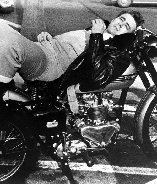 James Dean laying on his motorcycle <3