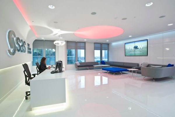 Office design and build for SAS software by Morgan Lovell.  Pink and blue mood lighting, high gloss finish on floors, wall and ceilings and phoneless desks give SAS's new office the WOW factor.  This reception area and meet and greet space creates a great first impression for visitors and colleagues.   See more of their activity based workplace in the case study by clicking through: