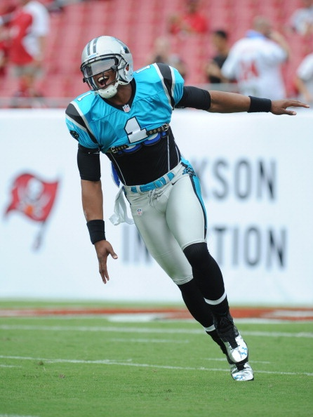Quarterback Cam Newton #1 of the Carolina Panthers flies to the field for warmups against the Tampa Bay Buccaneers during the season opening NFL game at Raymond James Stadium on September 9, 2012 in Tampa, Florida. (Photo by Al Messerschmidt/Getty Images)