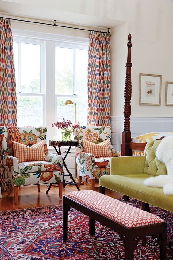 Sarah Richardson designed country style bedroom with bold red, green, and yellow home decor